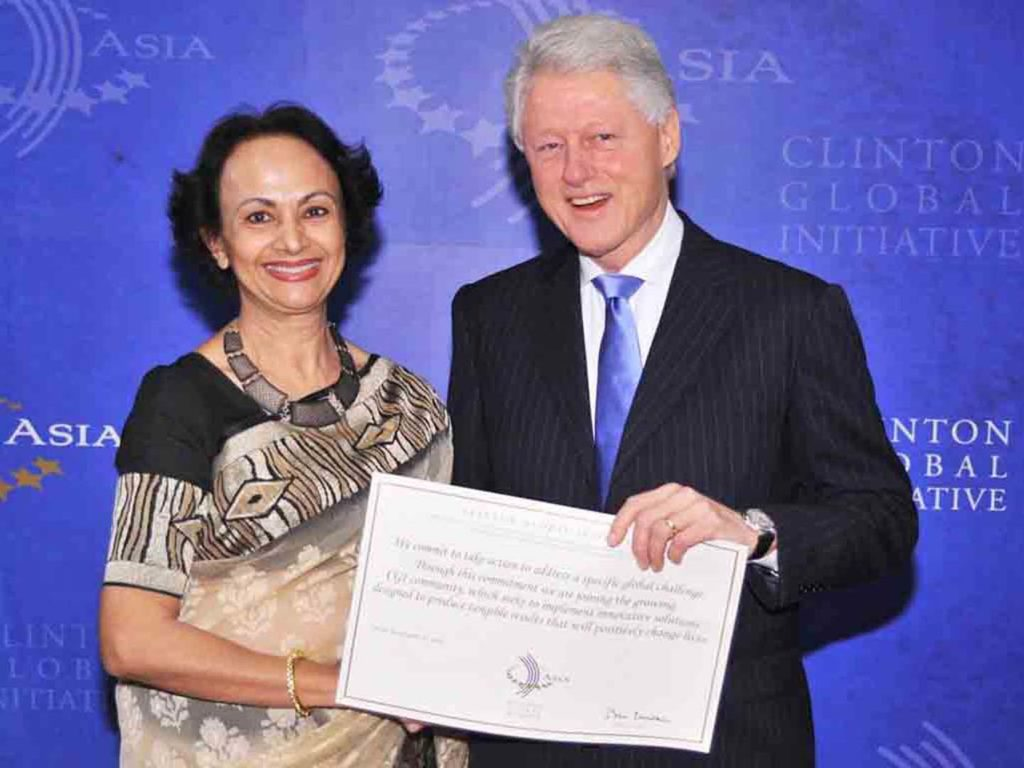 Clinton Global Initiative Award at the hands of President Bill Clinton